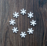 Snowflakes. On the wooden background royalty free stock photo