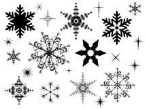 Snowflakesilhouettes Arkivbilder