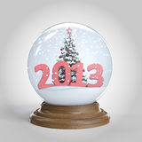 Snowglobe with 2013 new year message. Snowglobe  with chrismas tree and a big 2013 as new year present clipping path included Royalty Free Stock Images