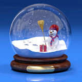 Snowglobe. A computer generated image of a snowglobe with a snowman and a gift box royalty free illustration