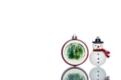 Snowglobe with christmas tree inside with snowman, copy space Royalty Free Stock Photography