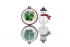 Snowglobe with christmas tree inside with snowman on white Backg Stock Image