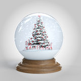Snowglobe with christmas tree and presents inside Stock Photos