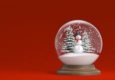 Snowglobe con el muñeco de nieve y los árboles en rojo Foto de archivo