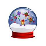 Snowglobe con los giftboxes de salto Foto de archivo libre de regalías