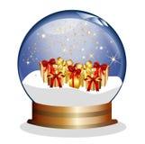 Snowglobe con los presentes y las estrellas de oro Imagenes de archivo