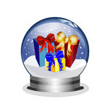 Snowglobe with giftboxes Stock Photo