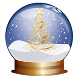 Snowglobe with golden christmas tree Royalty Free Stock Image