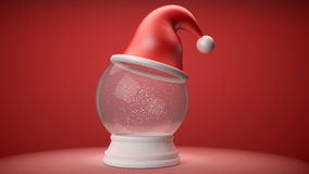 snowglobe with red hat Stock Photos