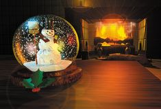 Snowglobe render. 3D render illustration depicting a snowglobe on a table by a fireplace Stock Photos