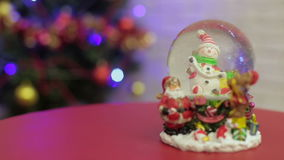Snowglobe with snowman on the Christmas tree. Background stock footage