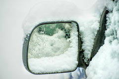Snowhat on a car mirror Royalty Free Stock Photo