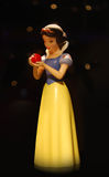 Snowhite holding apple Royalty Free Stock Photos