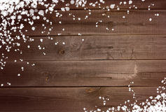 Snowing background on wooden surface Stock Images