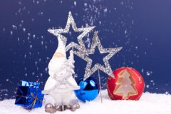 Snowing on blue background with santa. White santa figure on snow and blue background Royalty Free Stock Photography