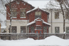 Snowing By A House Stock Images