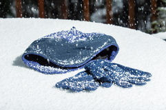 Snowing with cap and gloves Stock Image