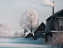 Snowing in Christmas winter in the village. Royalty Free Stock Images