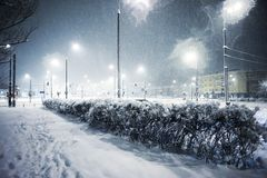 Snowing in the city. At night royalty free stock photos