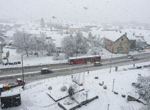 Snowing in city. Clear up street to reduce traffic jam, wintertime, Europe Stock Images