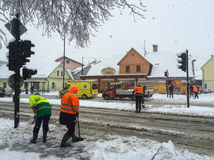 Snowing in city. Clear up street to reduce traffic jam, wintertime, Europe Stock Photo