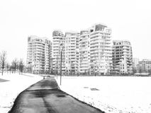 Snowing in Citylife, Milan. Milan, Lombardy, Italy: snow in late winter March at Citylife, residential buildings. Black and white Stock Photo