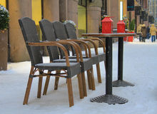 Snowing by an empty terrace Royalty Free Stock Images
