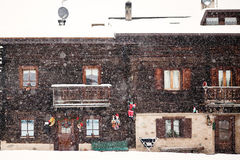 Snowing in front of traditional house Stock Photo