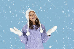 Snowing on girl with winter hat and gloves, Royalty Free Stock Images