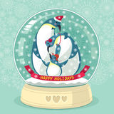 Snowing Globe With Penguin Family Inside. Vector illustration with cute penguins inside snowing globe. With text: Happy Holidays Stock Photo