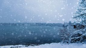 It is snowing at the lake stock photos