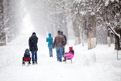 Snowing landscape in the park with people passing by Stock Photography