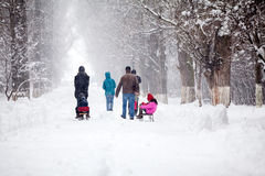 Snowing landscape in the park with people passing by Royalty Free Stock Photo