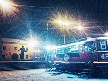 Snowing. Late winter evening in Lviv, Ukraine Stock Photo
