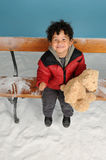 Snowing on a little boy with teddy bear Royalty Free Stock Images