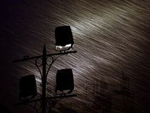 Snowing with long exposure. By reflectors royalty free stock photos