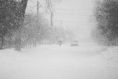 Snowing a lot in the lane Royalty Free Stock Images