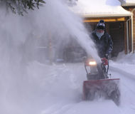 Snowing man senior 2. Senior using his snowblower on first day of December in Quebec stock photography