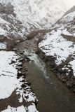 Snowing in Mountain Landscape with river Royalty Free Stock Photography
