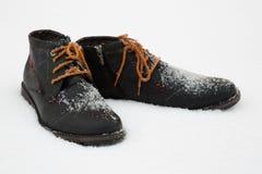 It is snowing - new winter dark boots Stock Photo