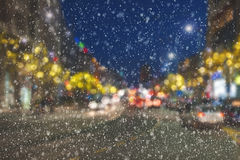 Snowing night on city streets Royalty Free Stock Photography