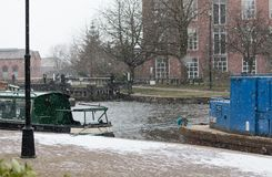 Snowing over the Canal. The snow falls over the Leeds Liverpool canal in Wigan Stock Photos