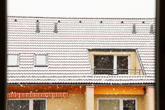 Snowing. Over the contemporary apartment house Royalty Free Stock Image