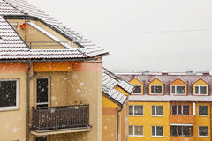 Snowing. Over the contemporary apartment house Royalty Free Stock Photos