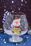 Snowing over Santa in a glass vase, Royalty Free Stock Photos