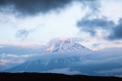 Peak of Tolbachik volcano at sunset in a smoky Kamchatka. Russia royalty free stock images