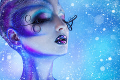Snowing photo of beauty woman with closed eyes and creative body Royalty Free Stock Images
