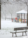 Snowing on the playground Stock Image