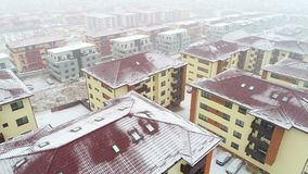 Snowing on Residential Area. Aerial view of residential area, snowing, winter time stock video footage