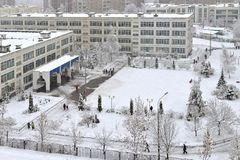 It is snowing. School students after lessons n winter. Moscow, Russia stock photo